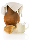 Old clay jug bread and a mug of milk on white background Royalty Free Stock Photo