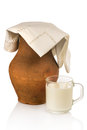 Old clay jug and mug of milk on white background Royalty Free Stock Photos