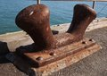 The old cleat on an military pier in san francisco bay this weathered rusted secured vessels and boats returning from wwii Royalty Free Stock Images