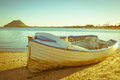 Old clinker design dinghy on beach Royalty Free Stock Photo