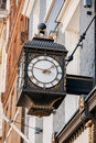 Old clock on the avenues of london street united kingdom Stock Image