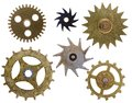 Old clock cogs isolated various shaped on a white background Stock Images