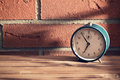 Old clock in front of a brick wall Royalty Free Stock Photo