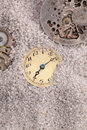 Old clocks antique buried in sand Royalty Free Stock Image