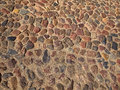 Old cobbled stones road background pattern Stock Photo