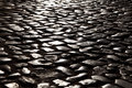 Old cobblestone pavement in tavira portugal Royalty Free Stock Images