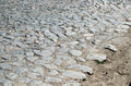Old cobblestone road paved with stones Royalty Free Stock Photo