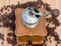 Old coffee grinder and coffee beans scene Stock Image