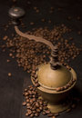 Old coffee grinder and coffee seeds Royalty Free Stock Photo
