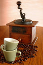 Old coffee grinder and cups Stock Photos