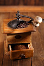 Old coffee mill with coffee beans close up nostalgic grinder ground and whole Stock Photos