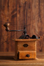 Old coffee mill with coffee beans close up nostalgic grinder ground and whole Royalty Free Stock Photography