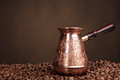 Old coffee pot and beans isolated on a brown background Stock Photography