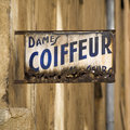 Old Coiffeur Sign in France Stock Photo