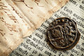 Old coin and manuscripts Royalty Free Stock Photography