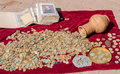 Old coins misc posted on the red cloth clay pot and postcards Stock Image