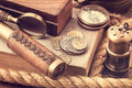 Old coins and nautical accessories vintage Royalty Free Stock Photo