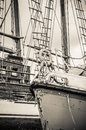 Old collapsing sailboats at the dock, close-up, sepia Royalty Free Stock Photo