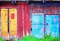 The old colored doors with locks. Royalty Free Stock Photo