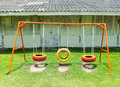 Old Colorful Empty Chain Swings made from Vehicle Wheels on Kids Playground in Thailand