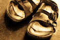 Old comfortable leather sandals closeup pair of Royalty Free Stock Photos
