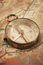 Old compass on map very shallow dof is completely out of focus Stock Photography