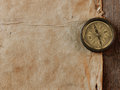 Old compass on vintage background the of an paper Royalty Free Stock Photography