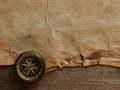Old compass on vintage background the of an paper Royalty Free Stock Photo