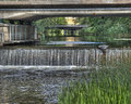 Old concrete foundation under the bridge with small fall in hdr city river borås sweden Royalty Free Stock Images