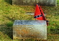 Old confederate soldier tombstone and confederate flag by gravestone Stock Photos