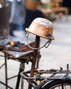 old copper cauldron and an antique bicycle saddle Royalty Free Stock Photo
