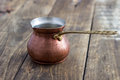 Old copper pot on table wooden close up Stock Image