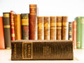 Old copy of the complete works of shakespeare an with a row books out focus in background Royalty Free Stock Images