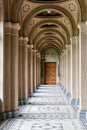 An old corridor with a beautiful floor and painted ceilings Royalty Free Stock Photo