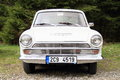 Old cortina white car parking by a forest Royalty Free Stock Photo