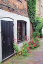 Old cottage door and flowers photo of an kent with courtyard full of pretty summer climbing plants Royalty Free Stock Images