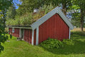 An old cottage, log cabin from the 1800s in Sweden... in HDR Royalty Free Stock Photo