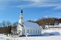 Old country church white with a steeple Royalty Free Stock Photo