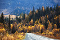 Old country road in autumn mountain forest Stock Image