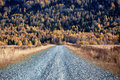 Old country road in autumn mountain forest Royalty Free Stock Photo