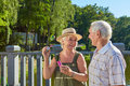 Old couple with bubble blower. Royalty Free Stock Photo