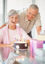 Old couple celebrating womans birthday at home Royalty Free Stock Image