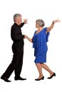 Old couple dancing amusing on a white background Stock Photography