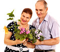 Old couple holding flower isolated Stock Photos