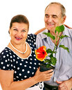 Old couple holding flower isolated Royalty Free Stock Photos