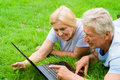 Old couple with laptop Royalty Free Stock Image
