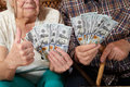 Old couple and money. Royalty Free Stock Photo