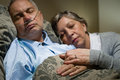 Old couple sleeping together man nasal cannula Royalty Free Stock Photo