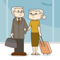 Old couple with a suitcase in the airport.