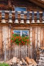 old cow bells under the roof of an Alpine mountain hut, Switzerland Royalty Free Stock Photo